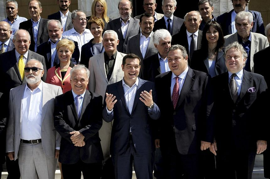 Greek Prime Minister Alexis Tsipras (centre) with (from left) Interior and Administrative Reconstruction Minister Panagiotis Kouroublis, Deputy Prime Minister Yannis Dragasakis, Defence Minister Panos Kammenos, Labour Minister George Katrougalos and