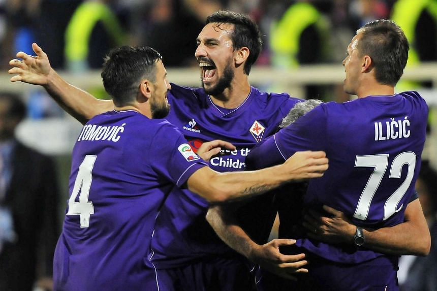 Josip Ilicic (right) celebrating with his teammates after scoring Fiorentina's first goal against Atalanta.