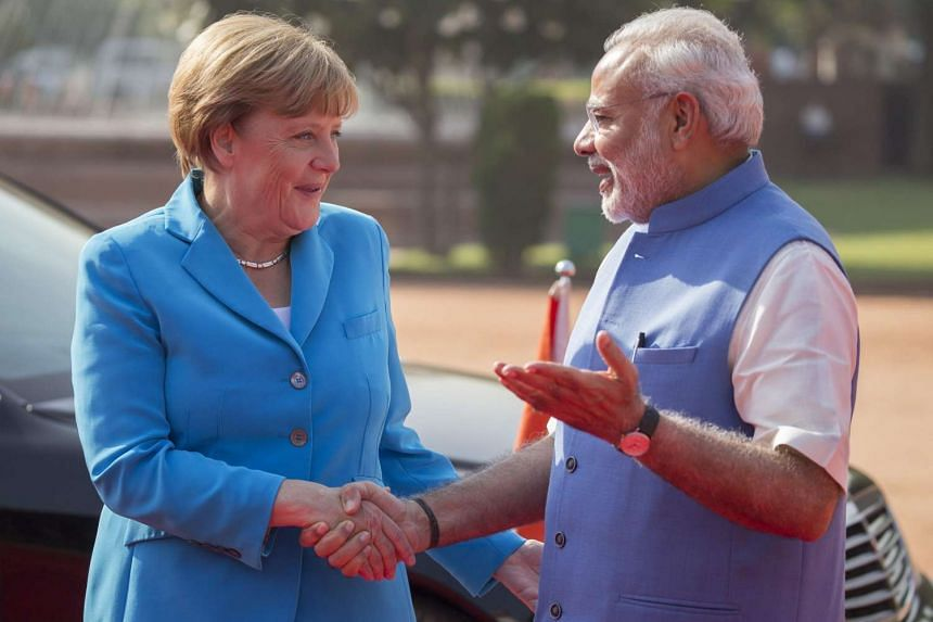 German Chancellor Angela Merkel being greeted by Indian Prime Minister Narendra Modi on her arrival in New Dehli, India, on Oct 5, 2015. Germany wants to be a partner in India's economic development, Chancellor Angela Merkel said in New Delhi ahead o