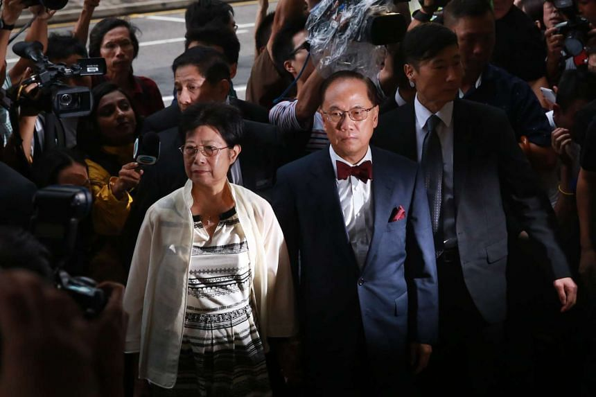 Donald Tsang, Hong Kong's former leader, and his wife Selina Tsang arriving at the Eastern Magistrates' Court in Hong Kong, China, on Monday, Oct. 5, 2015. Tsang, who completed his tenure as Hong Kong's No. 1 official in 2012, was charged with two co