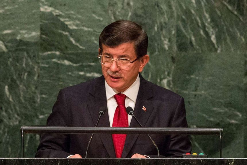 Turkey's Prime Minister Ahmet Davutoglu condemned a video purportedly showing militant's body dragged through the streets by an armoured police vehicle.