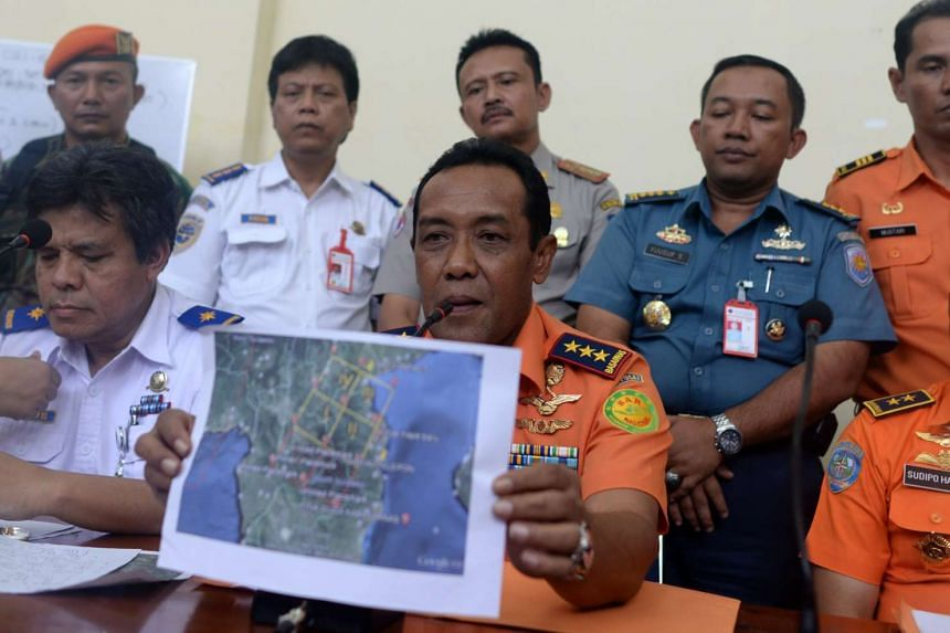 Indonesian National Search and Rescue Agency chief Bambang Soelistyo shows a map of the search area for the missing Aviastar plane, at Sultan Hasanuddin airport in Makassar, South Sulawesi, Indonesia, on Oct 3, 2015.