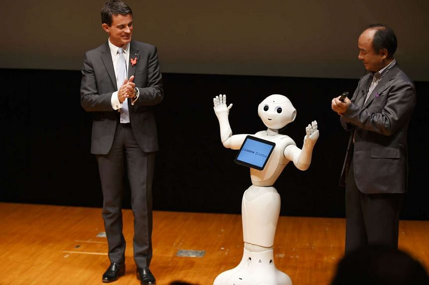French Prime Minister Manuel Valls was  introduced to Nao and Pepper, two chatty robots during a visit to Japan on Monday, Oct 5, 2015.