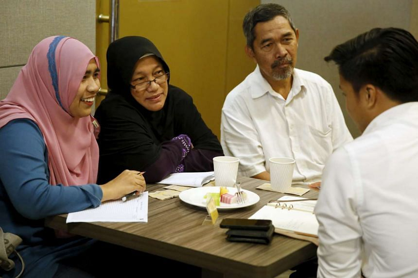 (From left) Ms Siti Aisha, together with her parents Zabidah and Jamali, attending Halal Speed Dating, a matchmaking event in Kuala Lumpur on Oct 3, 2015.