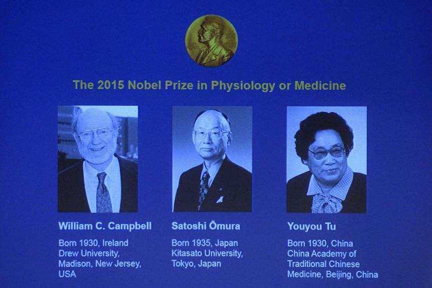 The portraits of the winners of the Nobel Medicine Prize 2015 (from left) Irish-born William Campbell, Satoshi Omura of Japan and China's Youyou Tu are displayed on a screen during a press conference at the Karolinska Institutet in Stockholm, Sweden