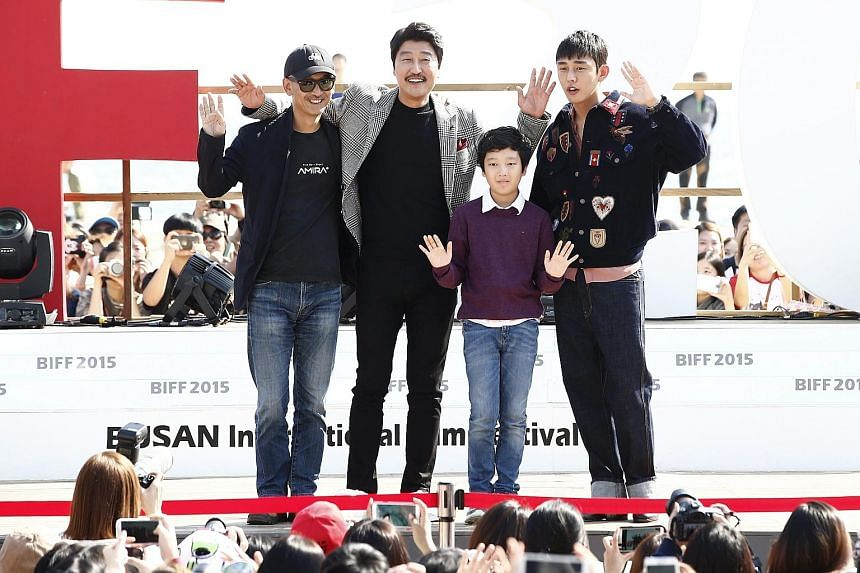 South Korean director Lee Joon Ik (far left, above) posing with actor Song Kang Ho, child actor Lee Hyo Je and actor Yoo Ah In at last Saturday's meet-and-greet for his movie The Throne at the Busan film festival. The period drama is South Korea's fo