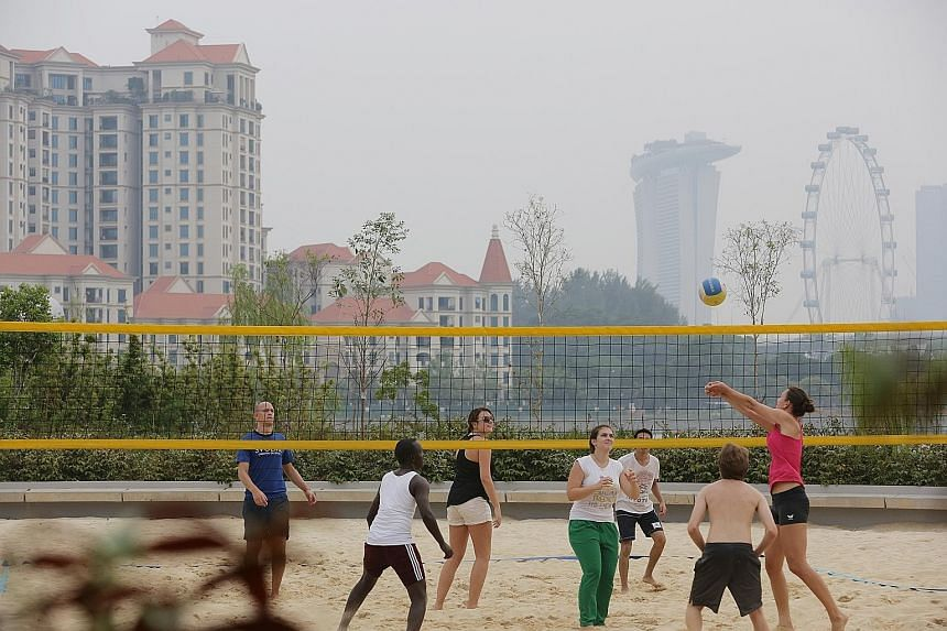 People enjoying the outdoors yesterday amid clearer skies. As of 6pm, the 24-hour Pollutant Standards Index (PSI) had fallen to between 81 and 98, in the high section of the moderate range. Today, the air quality is expected to be in the high end of