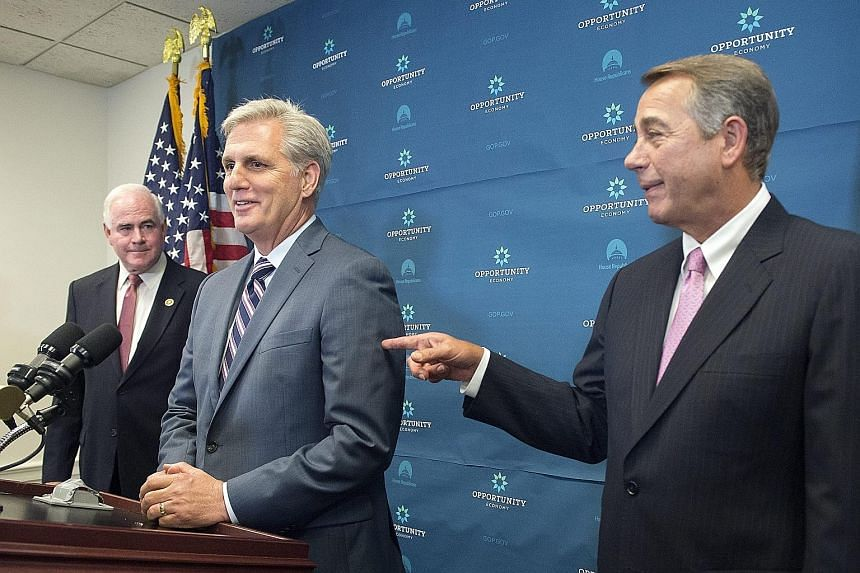 Mr Kevin McCarthy (centre) is the front runner to replace Mr John Boehner (right) as Speaker of the House.
