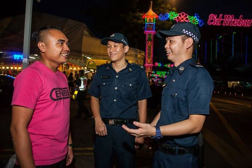 Police officers interacting with a member of the public.