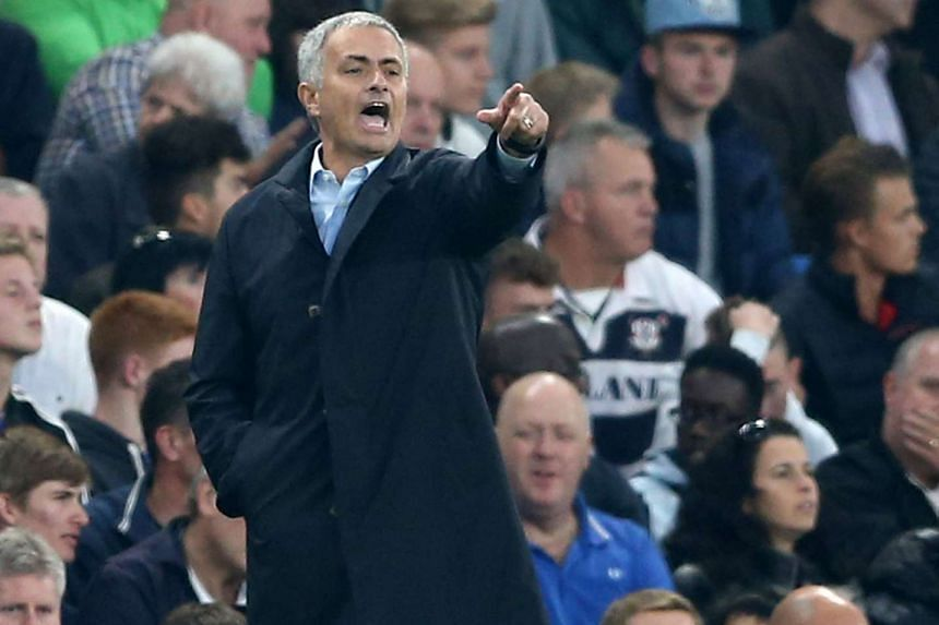 Chelsea manager Jose Mourinho gestures during the English Premier League football match against Southampton at Stamford Bridge in London on Oct 3, 2015.