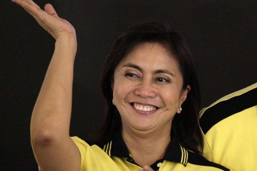 Filipino Congresswoman Leni Robredo waves to the crowd during a political party gathering in San Juan city, eastern Manila, on Oct 5, 2015.