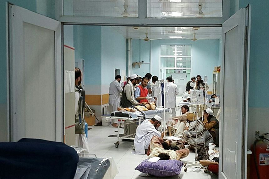 In this undated photograph released by Medecins Sans Frontieres (MSF) on Oct 3, 2015, Afghan MSF medical personnel treat civilians injured following an offensive against Taliban militants by Afghan and coalition forces at the MSF hospital in Kunduz.