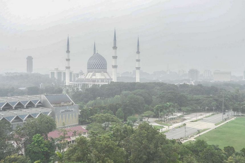 An aerial view of Shah Alam shrouded by haze on Oct 4, 2015. All schools in Peninsular Malaysia except for Kelantan were ordered to close for two days due to the worsening haze.