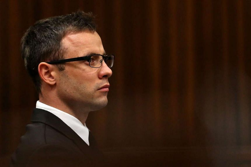 A picture taken on Oct 16, 2014 shows South African paralympic athlete Oscar Pistorius attending his sentencing hearing at the North Gauteng High Court in Pretoria.