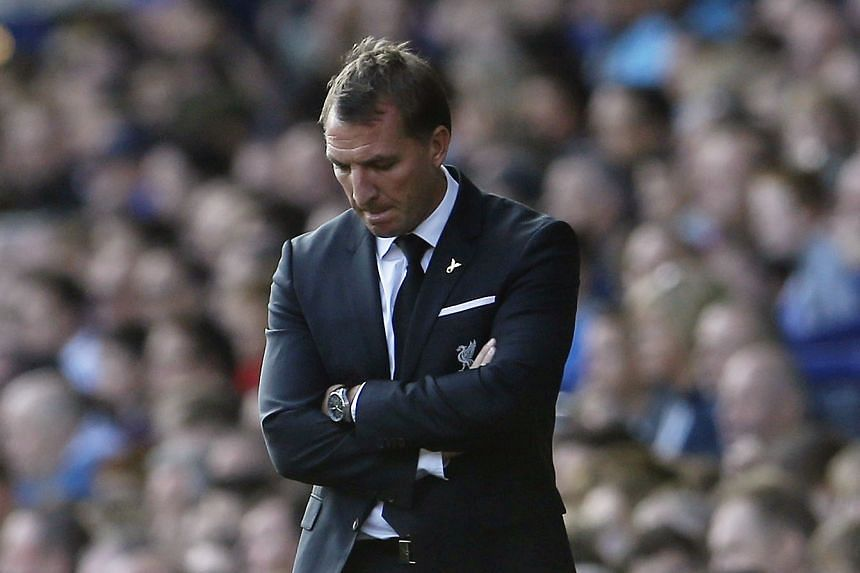 Liverpool manager Brendan Rodgers looks dejected after 1-1 draw with Everton on Sunday at  Merseyside.