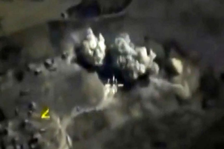 A screengrab taken on Oct 3  from a footage made available on the Russian Defence Ministry's official website, purporting to show an explosion after airstrikes carried out by Russian air force on what Russia says was an underground explosives warehou