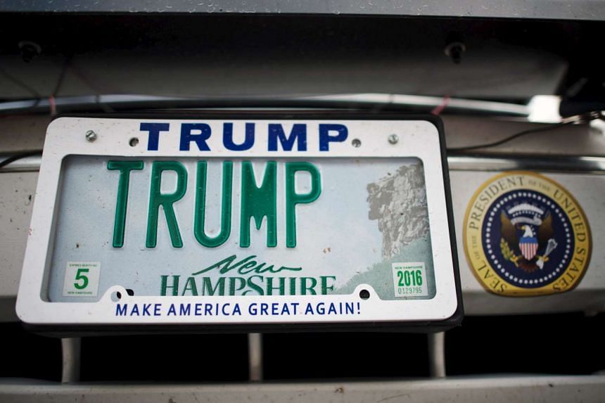 "A car with a licence plate reading ""TRUMP"" parked at Keene High School in New Hampshire, where US Republican presidential candidate Donald Trump held a campaign rally on Sept 30."