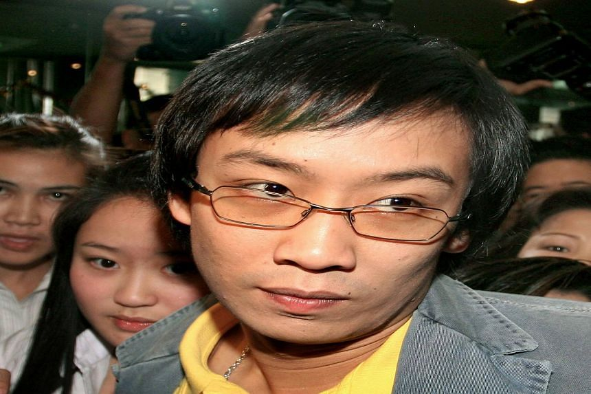 A photo taken on Jan 10, 2007, shows the son of Thailand's deposed premier Thaksin Shinawatra, Panthongtae Shinawatra (centre) and his sister Paethongtharn (left) arriving at the Asset Scrutinizing Committee in Bangkok.