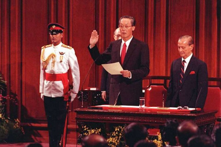 Mr Goh Chok Tong taking his oath at the swearing-in ceremony to become Singapore's second prime minister in 1990, as then President Wee Kim Wee looks on.