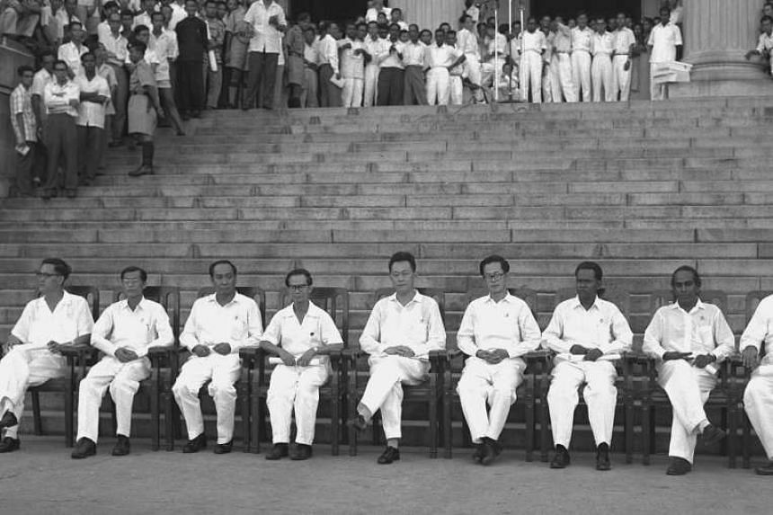 Cabinet ministers (from left) Yong Nyuk Lin, Ong Pang Boon, Goh Keng Swee, Toh Chin Chye, Lee Kuan Yew, Ong Eng Guan, Ahmad Ibrahim, S. Rajaratnam and K.M. Byrne at the swearing-in ceremony at the City Council Hall, on June 5, 1959. Former prime mini
