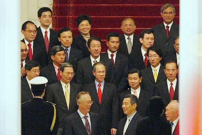 Mr Lee Hsien Loong (front row, centre) and the new Cabinet preparing for a photo at the swearing-in ceremony in 2004. He is flanked by Mr Goh Chok Tong and Mr Lee Kuan Yew.