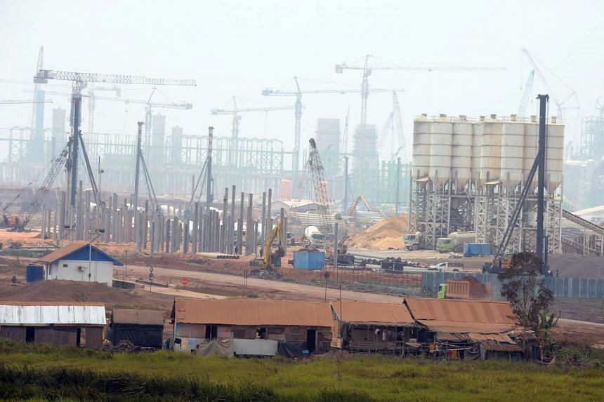 Villagers living near the OKI mill – which will run at full capacity by around 2018 – in South Sumatra. At 2,800ha, the mill, the river and sea ports are the size of a town.