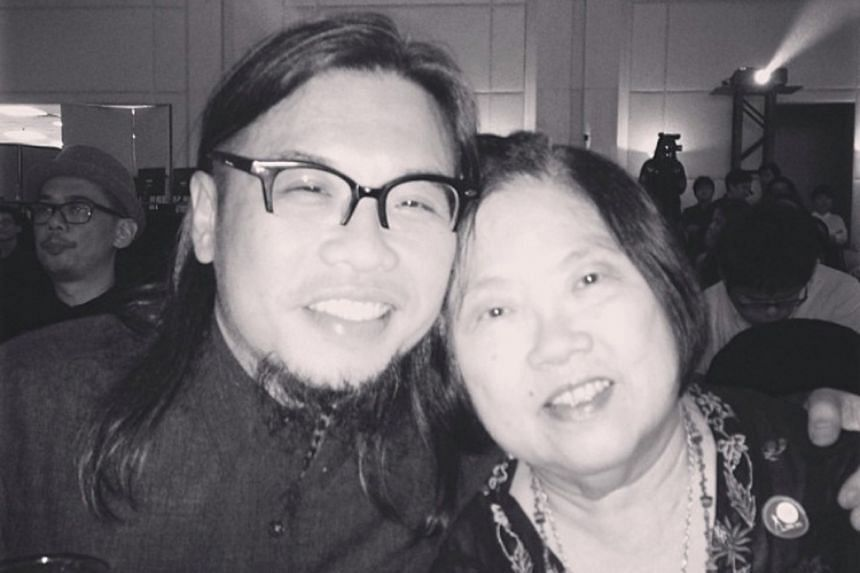 A proud day for Mr Pann Lim and his mother, Madam Ching Guek Chow, at the Gong CCA Awards in 2013, where his agency won major accolades.