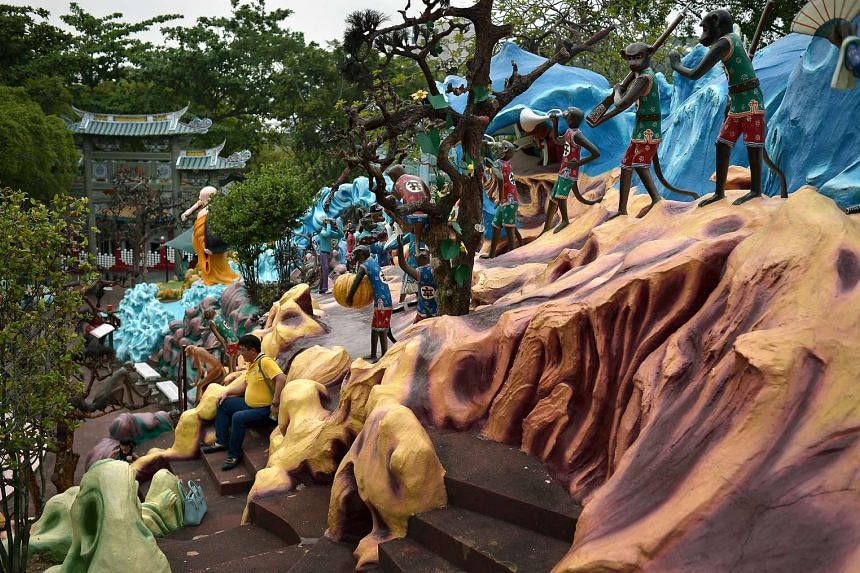 A visitor posing for a snapshot at Haw Par Villa yesterday. In August, the Singapore Tourism Board, which owns the park, appointed travel company Journeys to manage the site over the next three years.