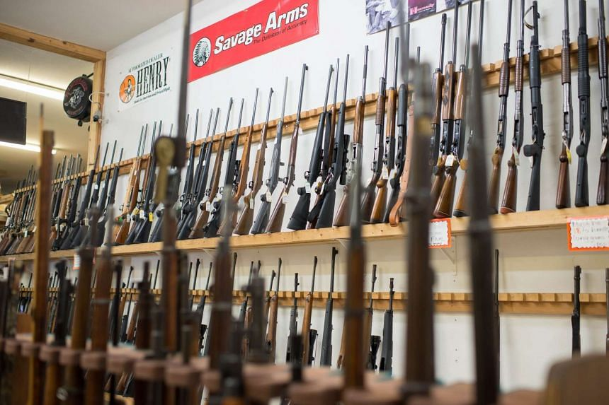 Weapons on display at a gun shop in Roseburg, where the latest mass shooting in the US occurred last week. Gunman Christopher Harper-Mercer had at least 14 guns, all bought legally.