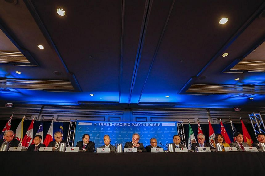 Trade negotiators from the 12 Pacific Rim nations participating in the closing press conference in Atlanta, Georgia, US, on Oct 5, 2015.