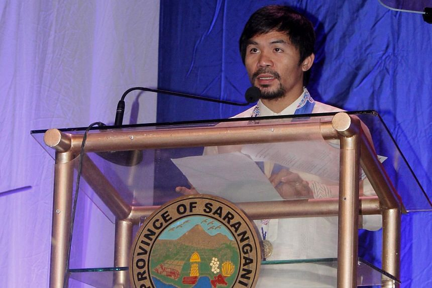 Boxing icon Manny Pacquiao speaking to supporters during a political gathering in the town of Alabel, southern Philippines, on Oct 5.