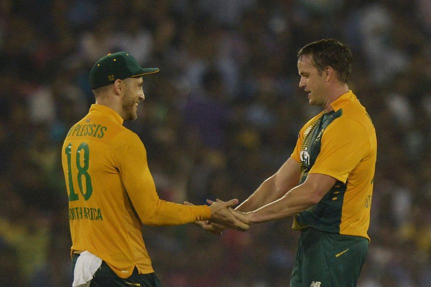 South Africa's captain Faf du Plessis (left) congratulating Albie Morkel for taking the wicket of India's Bhuvneshwar Kumar during the second T20 cricket match between India and South Africa on Oct 5, 2015.