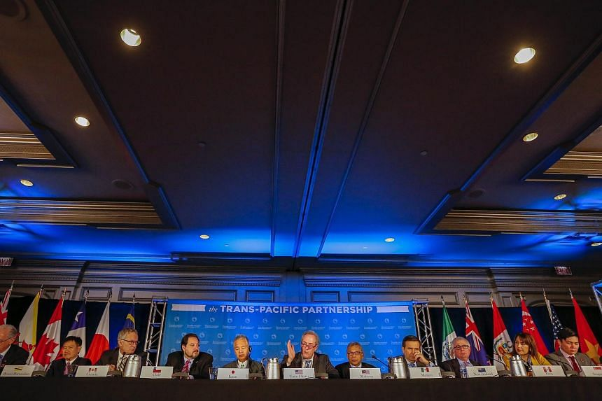 Trade ministers from the twelve Trans-Pacific Partnership (TPP) member countries participate in the closing press conference in Atlanta, Georgia, USA, Oct 5, 2015.