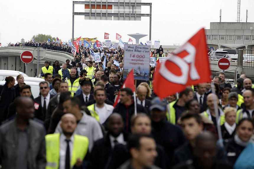 Employees of French flag carrier Air France demonstrating near the company headquarters in Roissy-en-France, on Oct 5, 2015.