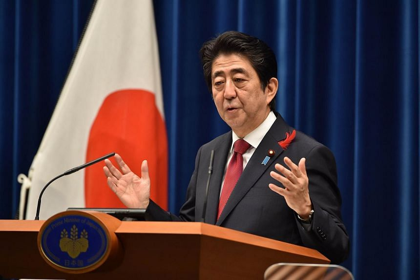Japan's Prime Minister Shinzo Abe speaks during a press conference at Abe's official residence in Tokyo on Oct 6, 2015.