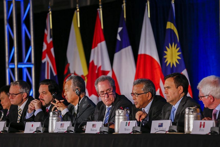 US Trade Representative Michael Froman (centre) is flanked by international counterparts during a press conference after the Trans-Pacific Partnership agreement was signed in Atlanta on Oct 5.