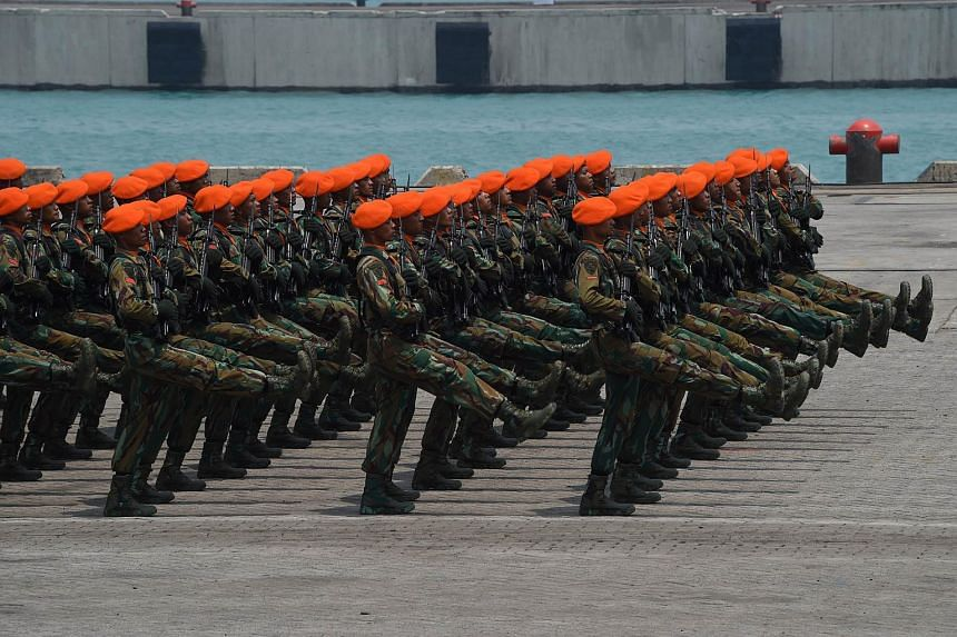 Indonesian military troops marching in formation during an exercise at a naval base in Cilegon, West Java province on Oct 3, 2015.