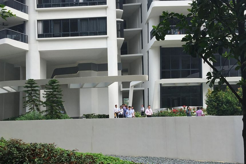 Police officers seen at the foot of Block 3 of D'Leedon Condominium.
