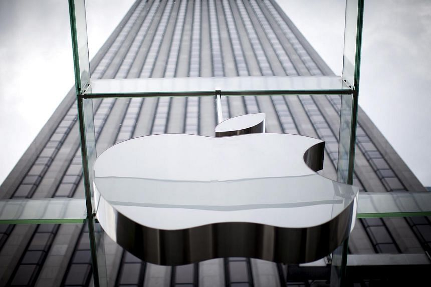 An Apple logo hangs above the entrance to the Apple store on 5th Avenue in Manhattan, New York.