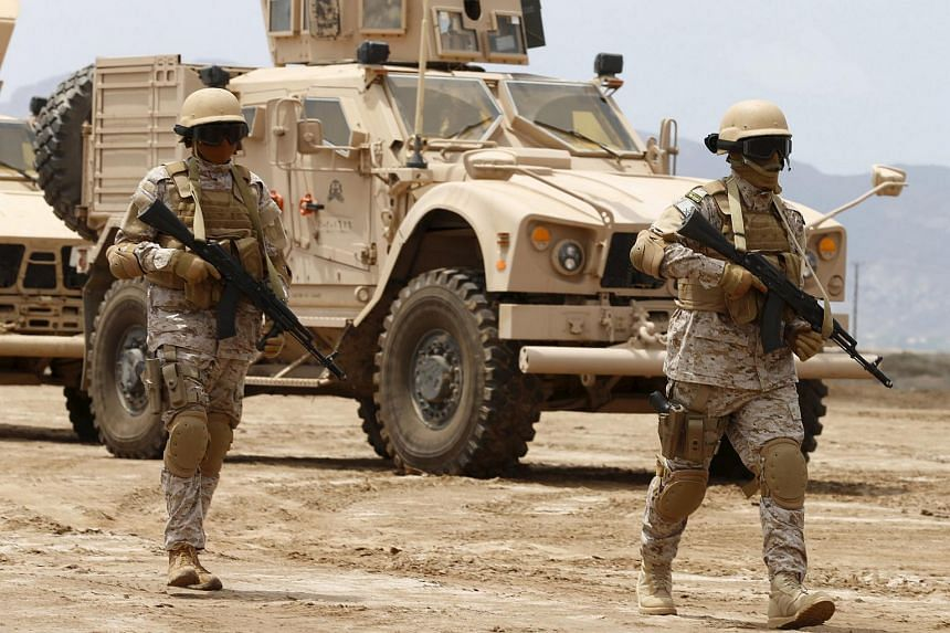 Saudi troops walking at their base in Yemen's southern port city of Aden on Sept 28, 2015.