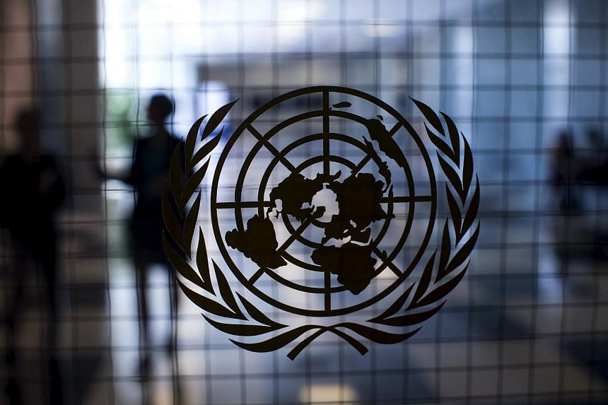 A United Nations logo is seen on a glass door in the Assembly Building at the United Nations headquarters in New York.