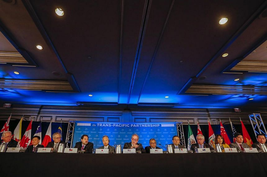 Trade ministers from the 12 Trans-Pacific Partnership member countries at a press conference in Atlanta on Oct 5.