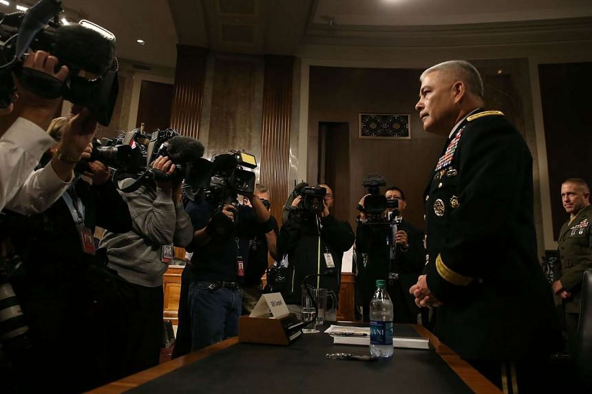 US Army General John Campbell commander of the Resolute Support Mission and United States Force Afghanistan, prepares to testify during a Senate Armed Services Committee hearing on Capitol Hill on Oct 6, 2015 in Washington, DC. The committee question
