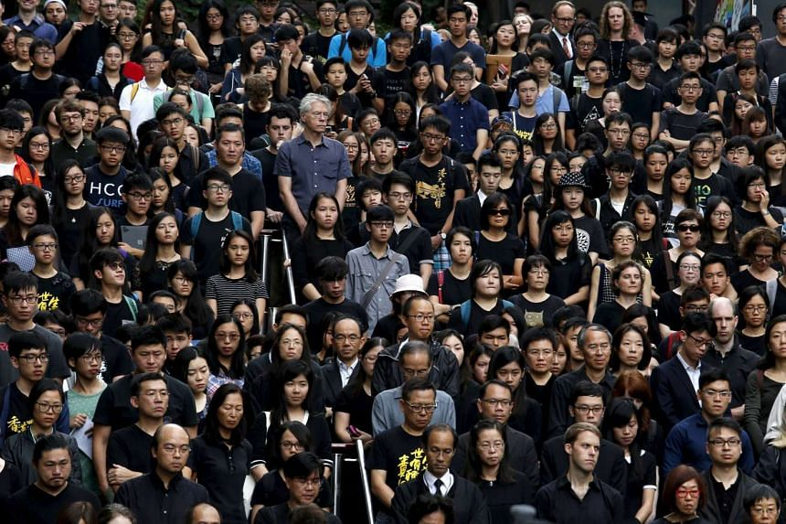 Staff and students of the University of Hong Kong stage a silent protest against the university's governing council inside their campus in Hong Kong on Oct 6, 2015.