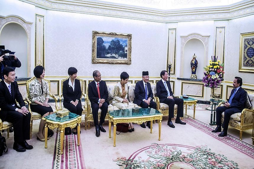 (From right) Brunei Sultan Hassanal Bolkiah with Singapore Deputy Prime Minister and Coordinating Minister for National Security Teo Chee Hean; Brunei Second Minister of Finance Pehin Haji Abdul Rahman; Singapore Minister for Culture, Community and Y