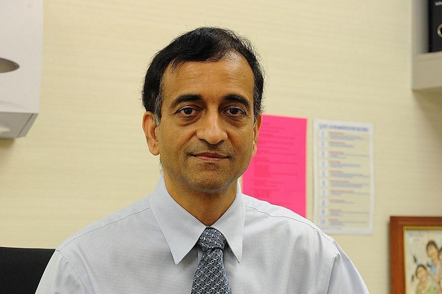 Besides running his clinic in Raffles Hospital, Dr N. Venketasubramanian Ramani goes to the National University of Singapore to teach students and attend meetings with research colleagues.