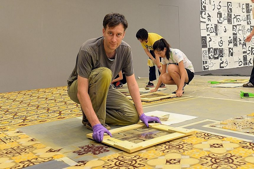 French artist Laurent Mareschal (above) uses spices to create floor tiles which are based on Islamic geometric patterns.