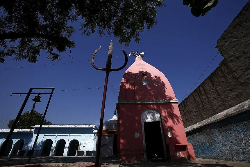 "The temple in Bisada village in Uttar Pradesh that alerted the villagers to the ""cow killing"". Vigilantes from Save the Cow heard a rumour that a cow's slaughtered remains had been found near an electrical transformer and went hunting for the alleged"