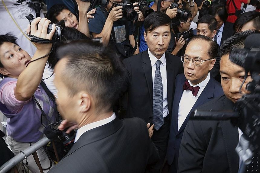 Donald Tsang, in his trademark bow tie, leaving the court in Hong Kong yesterday. His tenure as chief executive had invited criticisms of collusion between government officials and tycoons.
