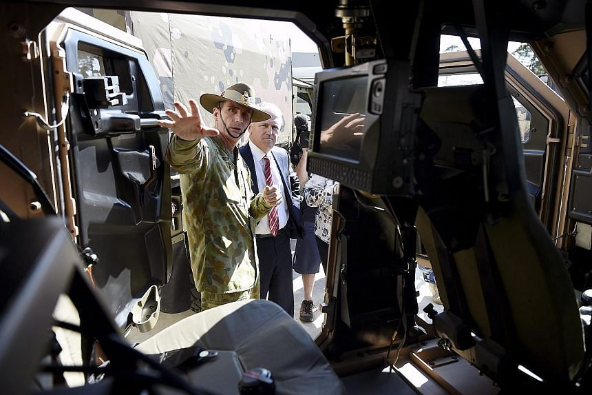 Lieutenant- General Angus John Campbell showing Australian Prime Minister Malcolm Turnbull a new Hawkei military vehicle at the Land Engineering Agency Proving Ground, in Victoria, yesterday.